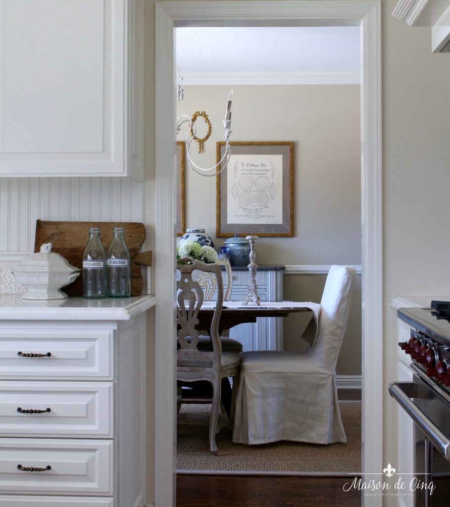 summer kitchen tour view into dining room french country style with blue accents