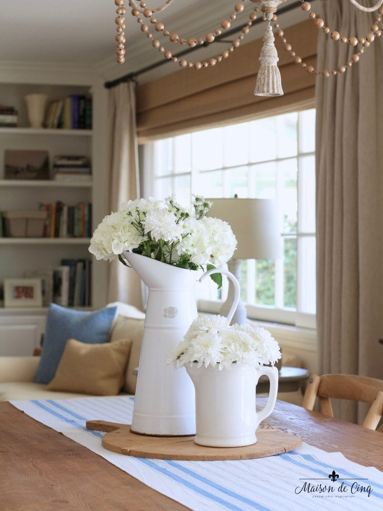 summer kitchen tour view to family room white flowers farmhouse table chandelier