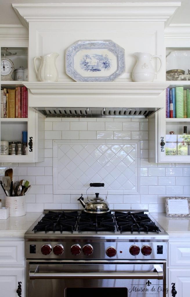 summer kitchen tour blue and white transferware white pitchers on stove mantel farmhouse style