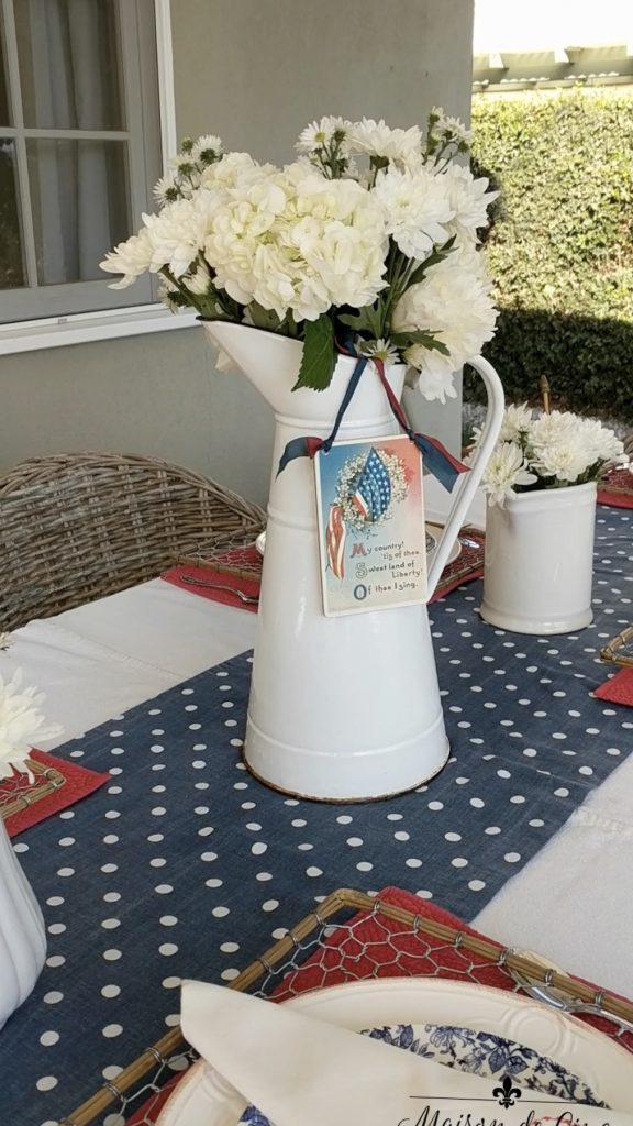 patriotic tablescape white flowers centerpiece blue and white runner