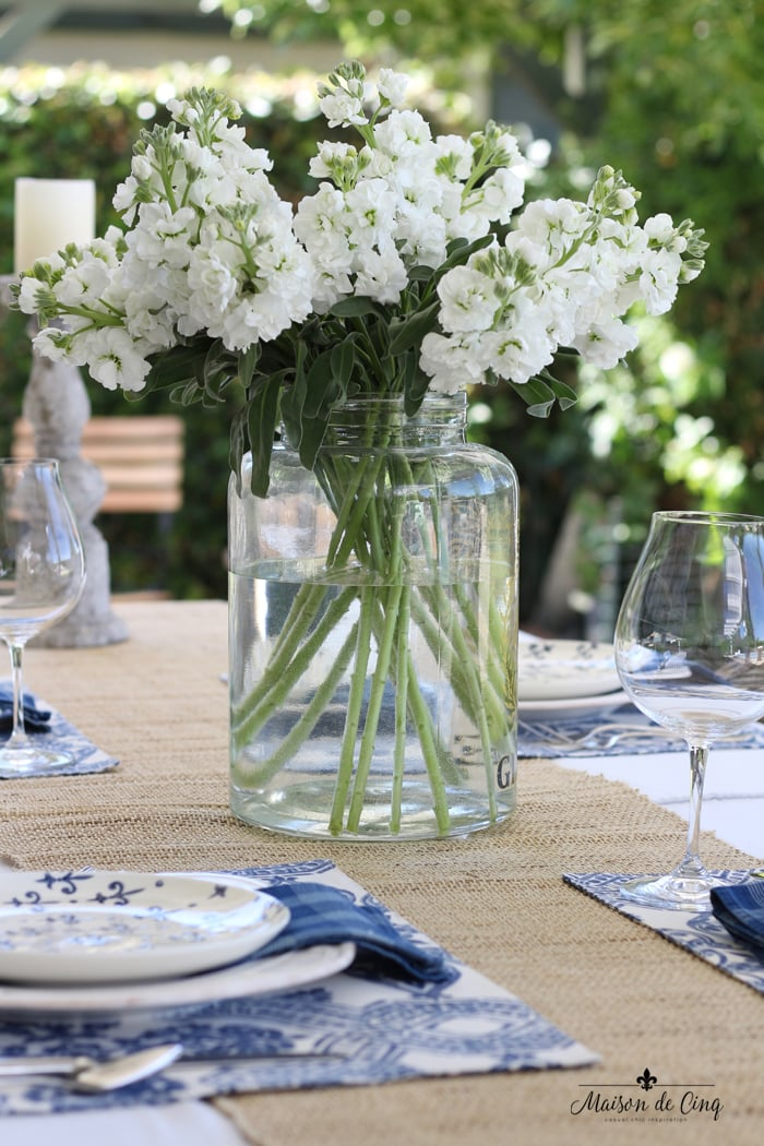 blue and white tablescape summer table setting white flowers glass vase backyard dining