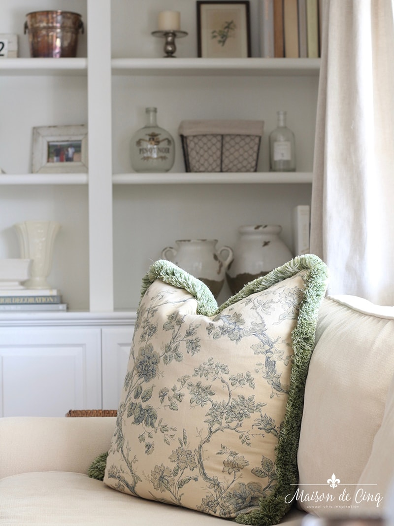 how to style book shelves french country style room green floral pillow neutral styling