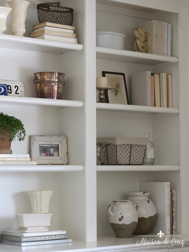 how to style book shelves details neutral items books baskets vases