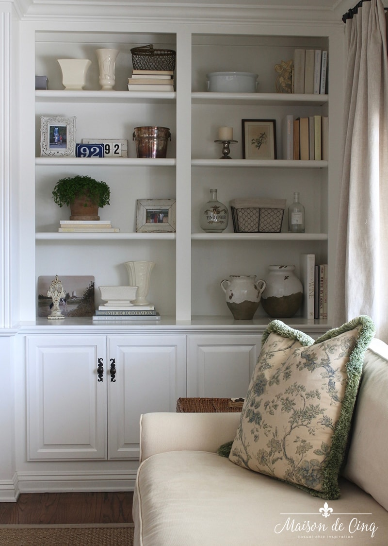 how to style book shelves white cabinets french country style room curtains