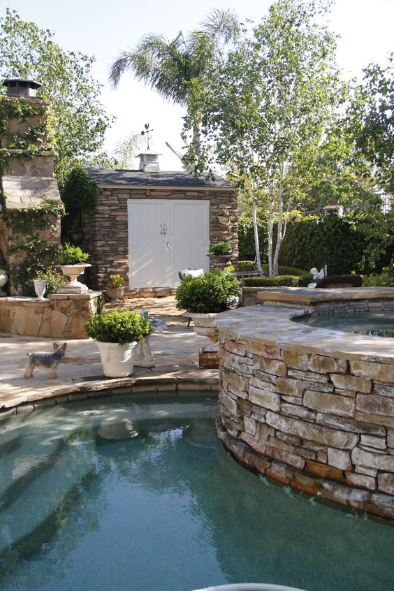 backyard renovation inspiration stone surrounding pool and shed charming french inspired yard