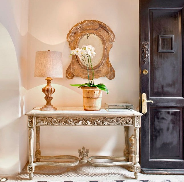 french style mirror over carved console table with black door gorgeous french country style