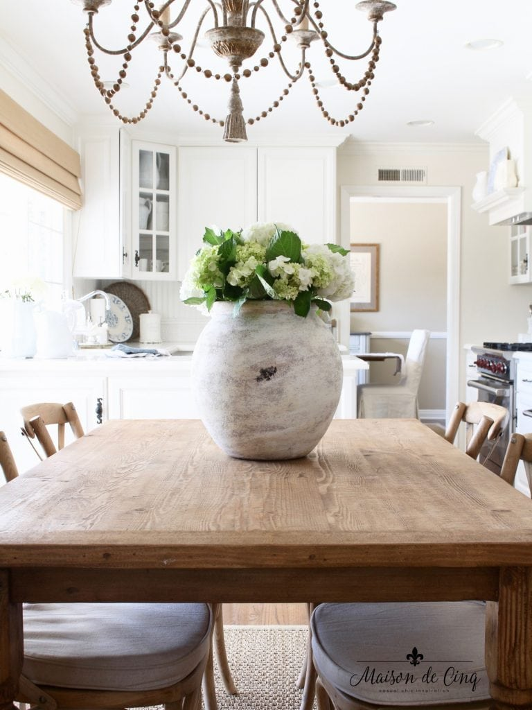 farmhouse table white kitchen french country style dramatic white vase white flowers