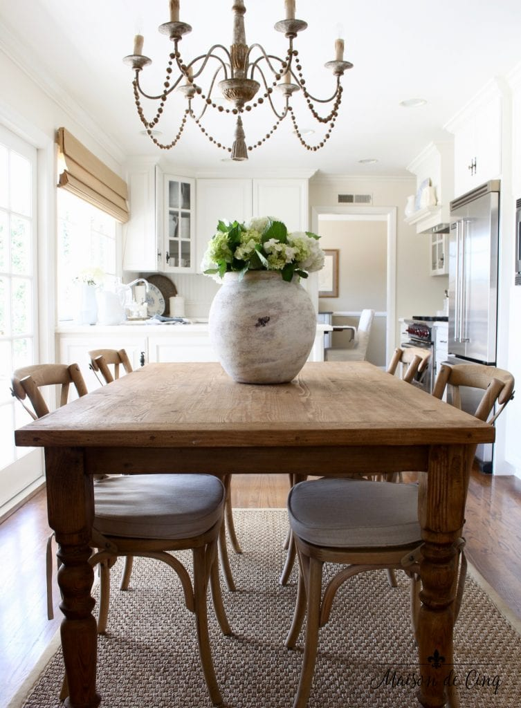 farmhouse table in gorgeous french country kitchen chandelier gorgeous white vase flowers