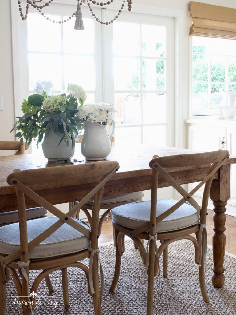 french cafe chairs breakfast area farmhouse table french doors window
