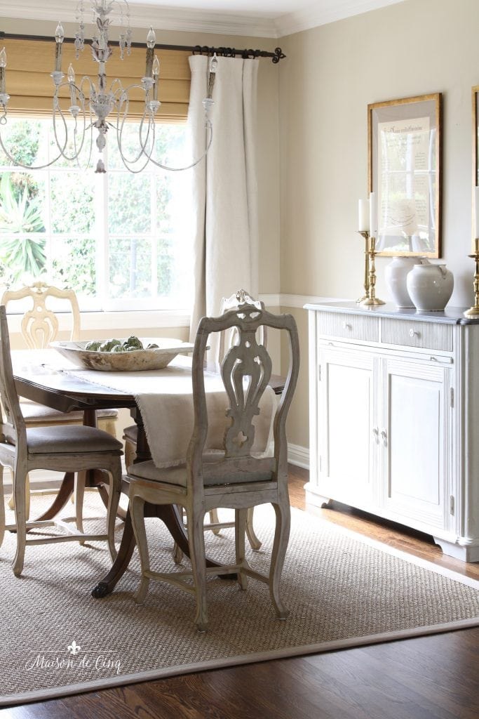 french country chandelier white candle style in pretty neutral dining room
