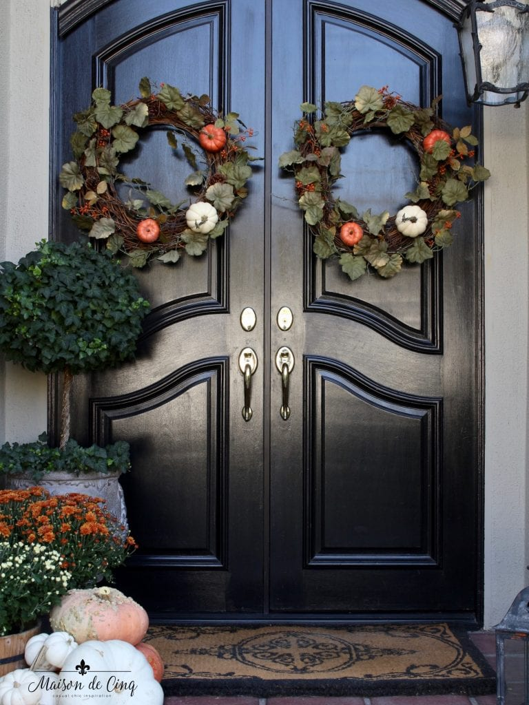 fall front porch pretty black doors topiary pumpkins lantern