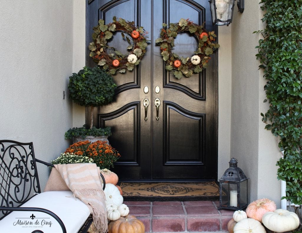 fall front porch inviting french country style bench wreaths topiary mums