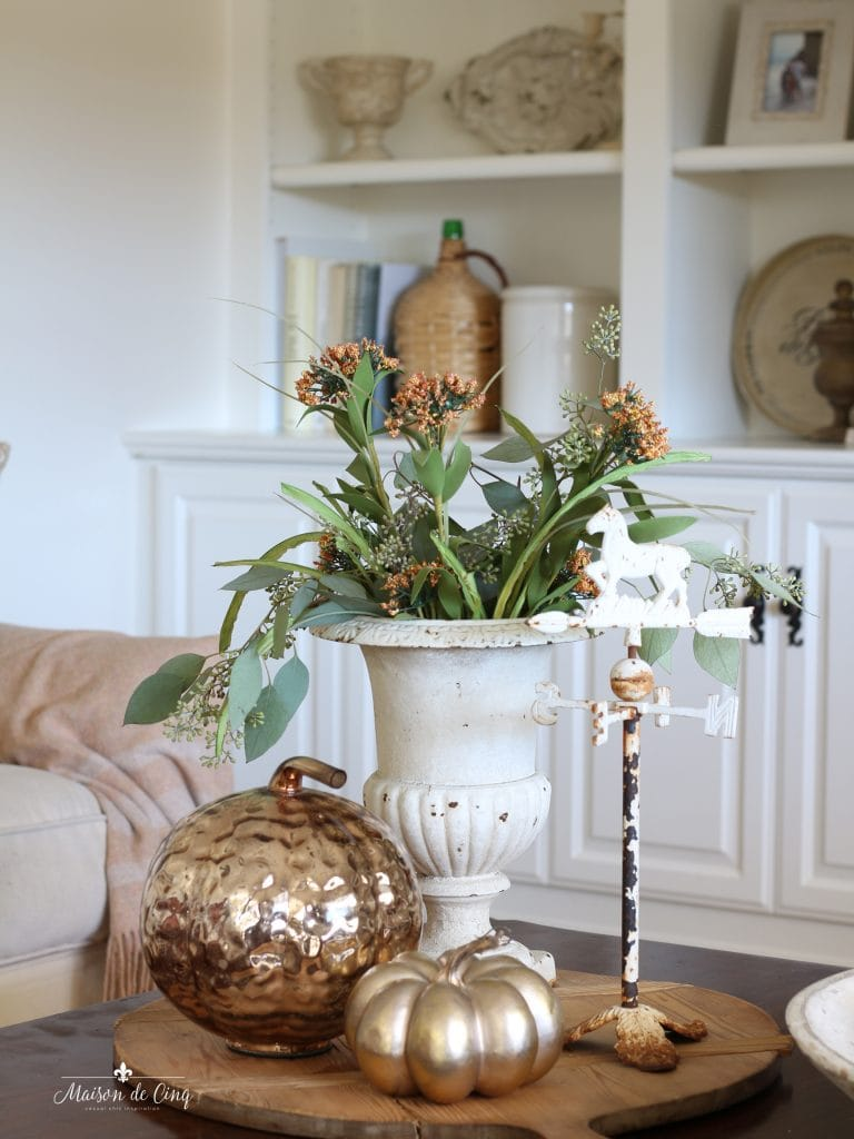 fall family room coral flowers in french urn with copper pumpkins