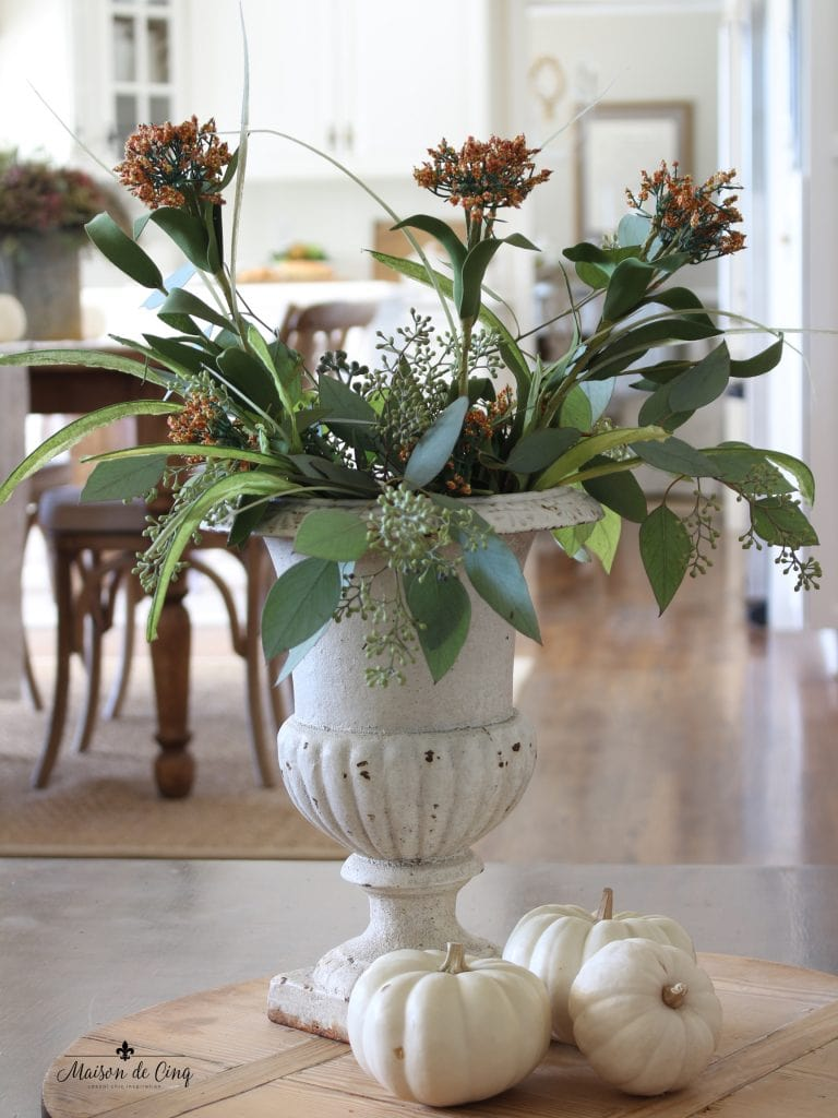 fall family room coral flowers in white french urn in white french country kitchen