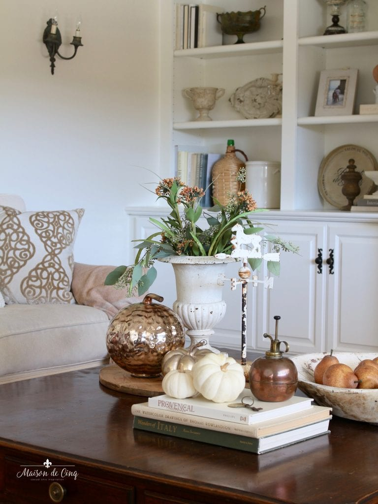 fall family room with copper accents flowers tans creams and faded rusts fall decor