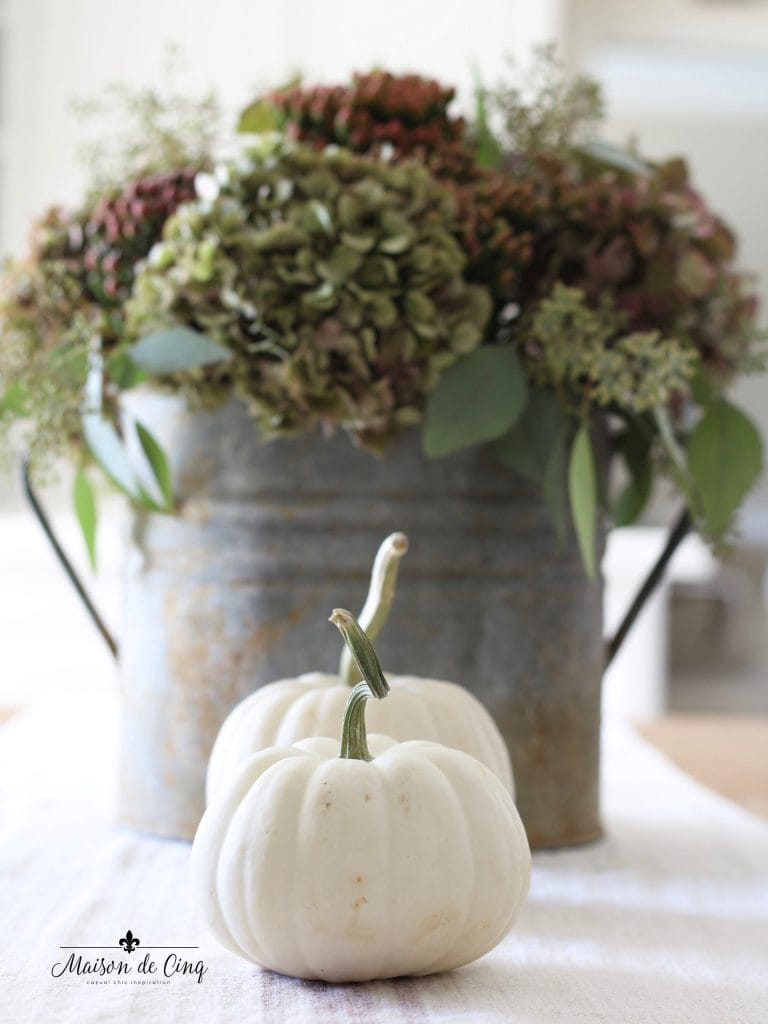 fall kitchen tour hydrangeas in vintage french bucket white pumpkins in white farmhouse kitchen
