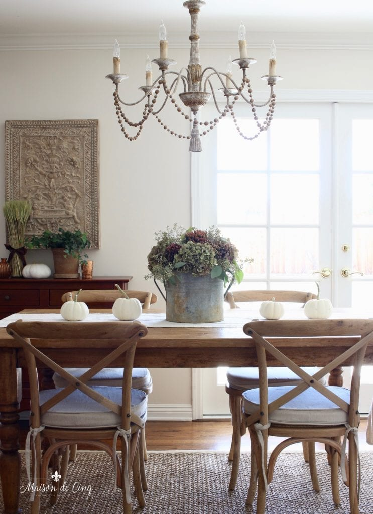 fall kitchen tour farmhouse table chandelier fall flowers hydrangeas chandelier french country style