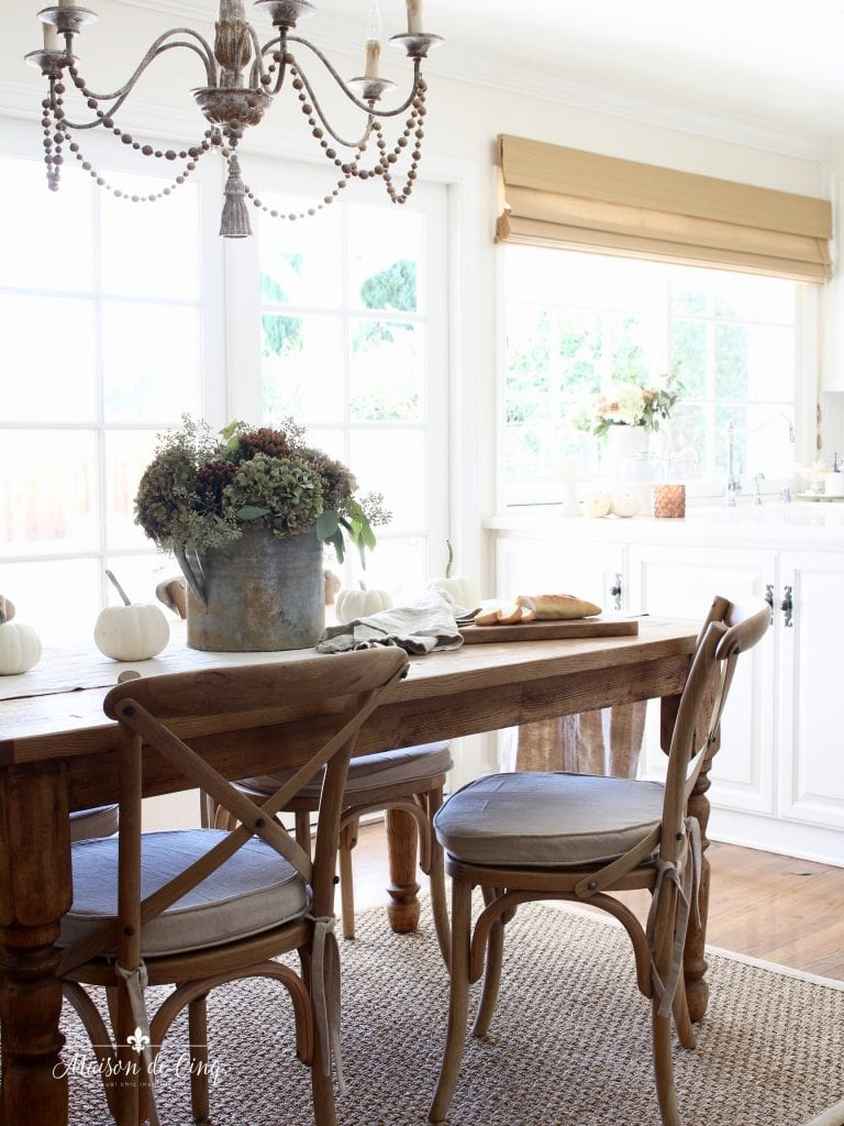 fall kitchen tour farmhouse table hydrangeas fall flowers white kitchen chandelier