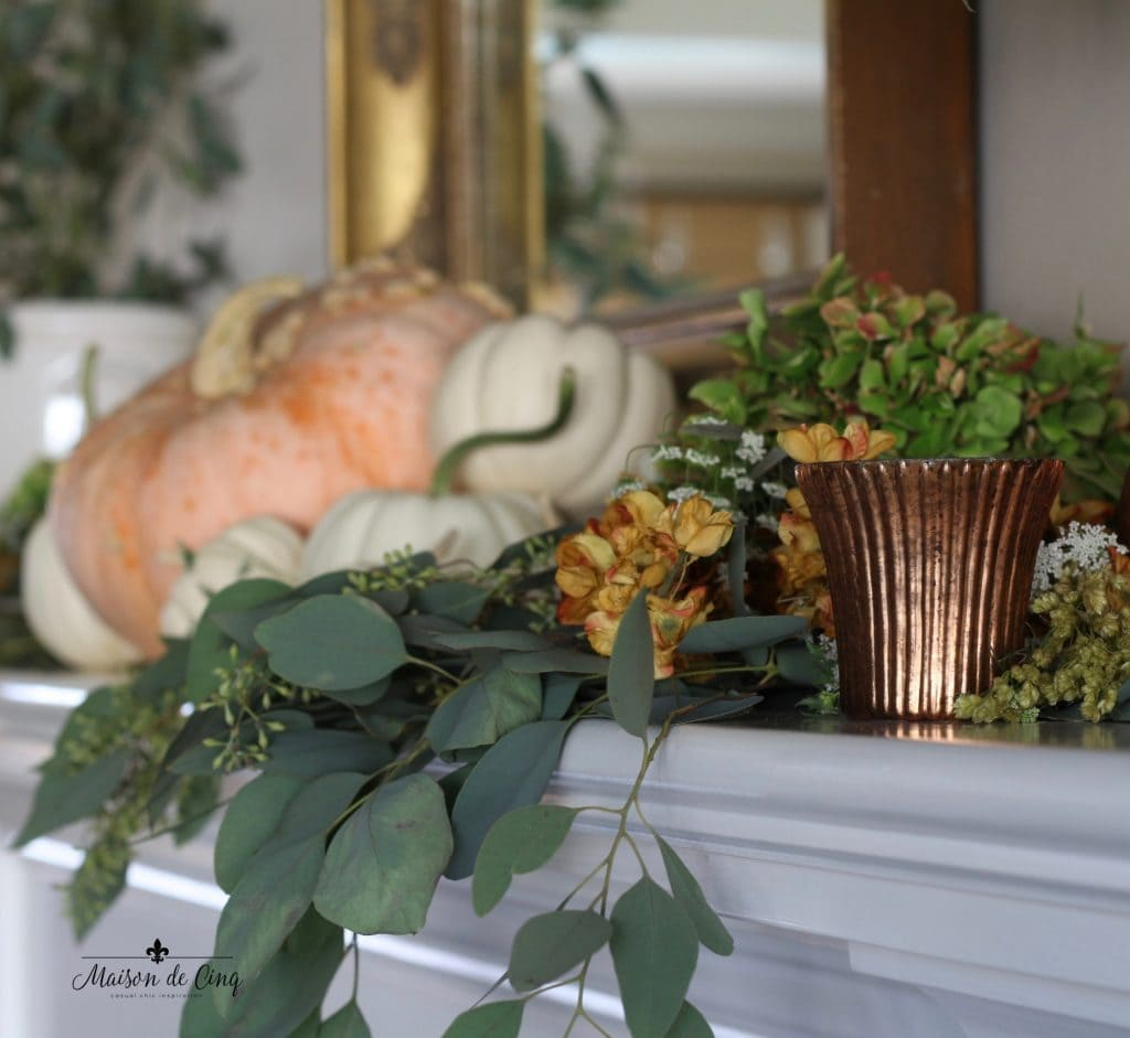 fall mantel romantic style pumpkins eucalyptus copper votives and hydrangeas