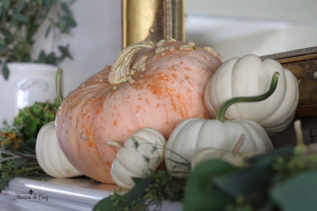 fall mantel with pumpkins and eucalyptus