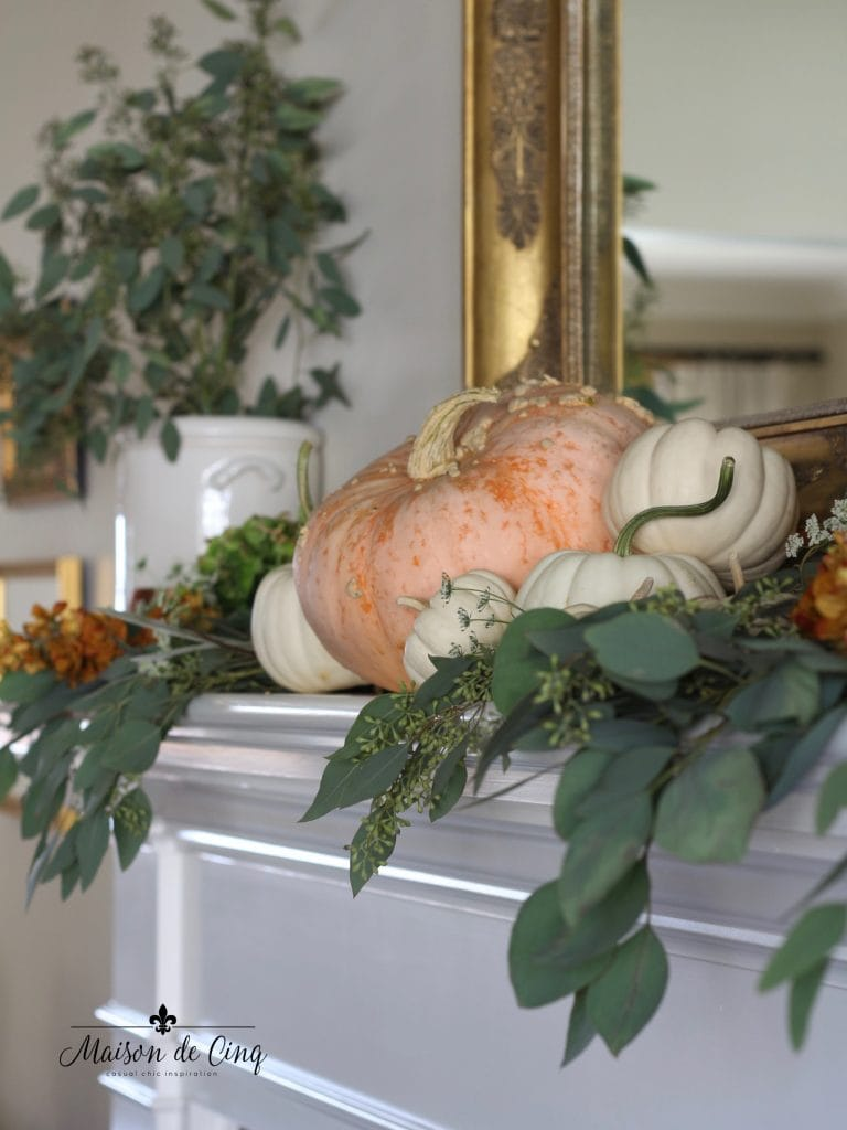 fall mantel pumpkins eucalyptus gold mirror autumn decor