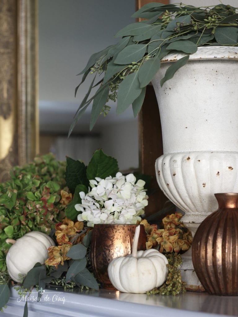 fall mantel copper votives hydrangeas eucalyptus french urn