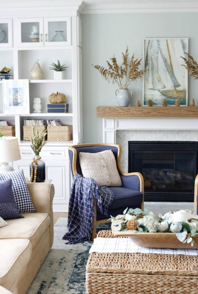 Dark blue armchair in corner by fireplace.