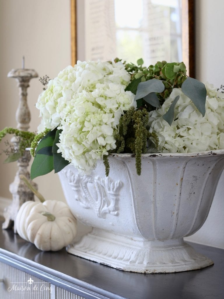 neutral fall table with white hydrangeas in french planter and white pumpkins gorgeous inspiration