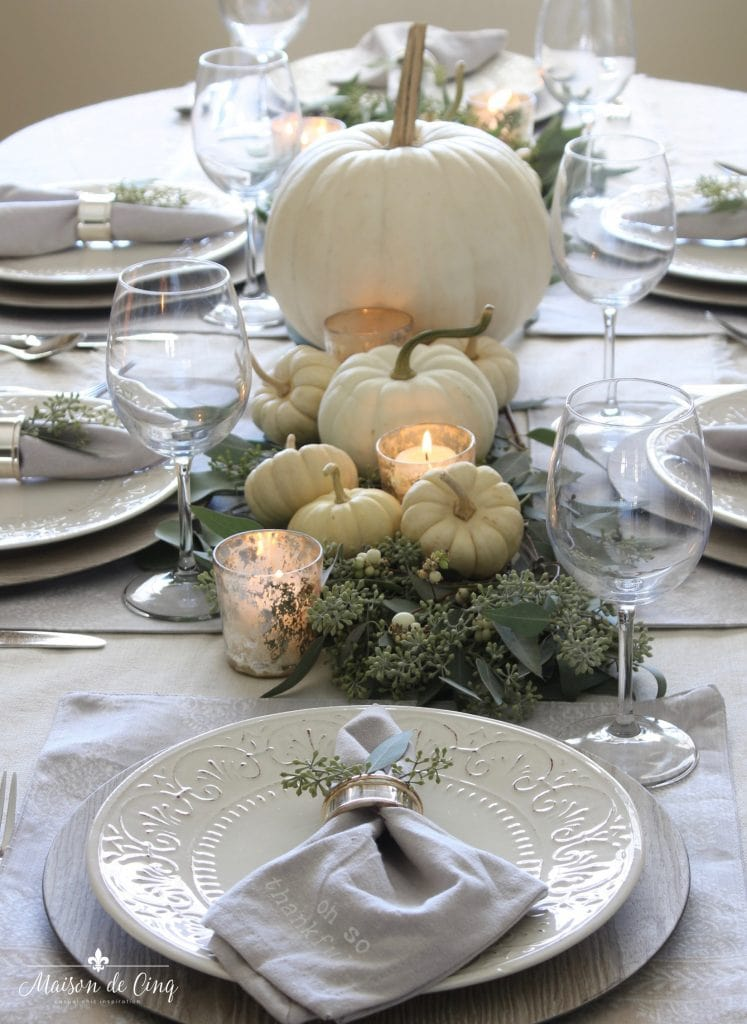 neutral fall table white pumpkins and eucalyptus with white plates grey napkins