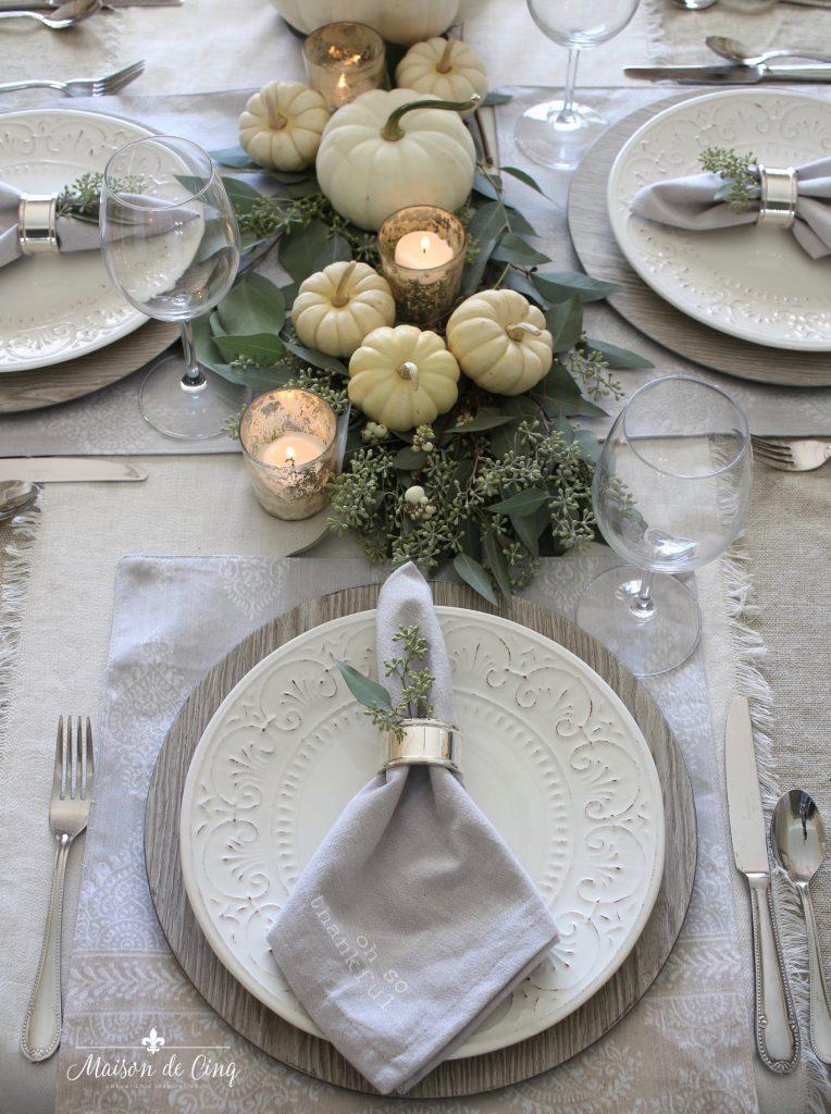 neutral fall table white pumpkins eucalyptus centerpiece white plates