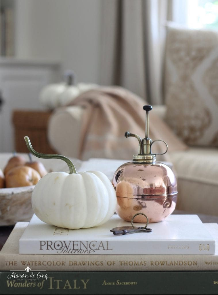 decorating with copper vintage plant mister with white pumpkin fall decorating
