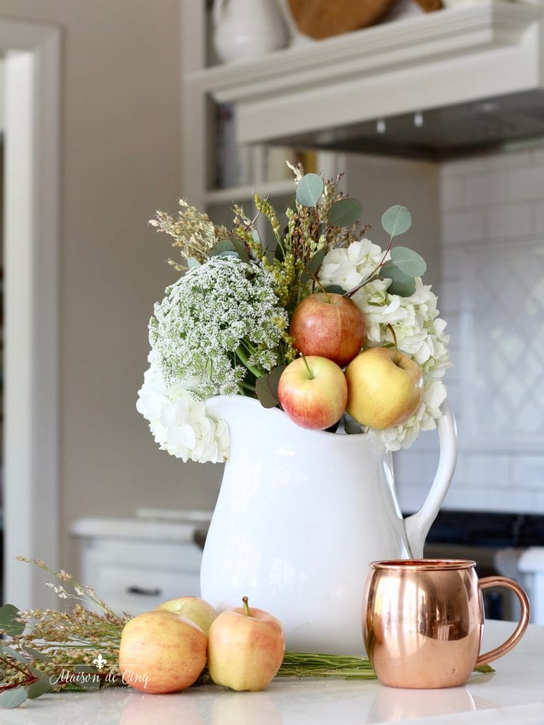 decorating with copper mug white kitchen fall flowers