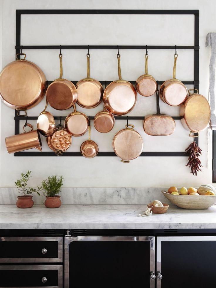 decorating with copper pots in gorgeous black and white kitchen