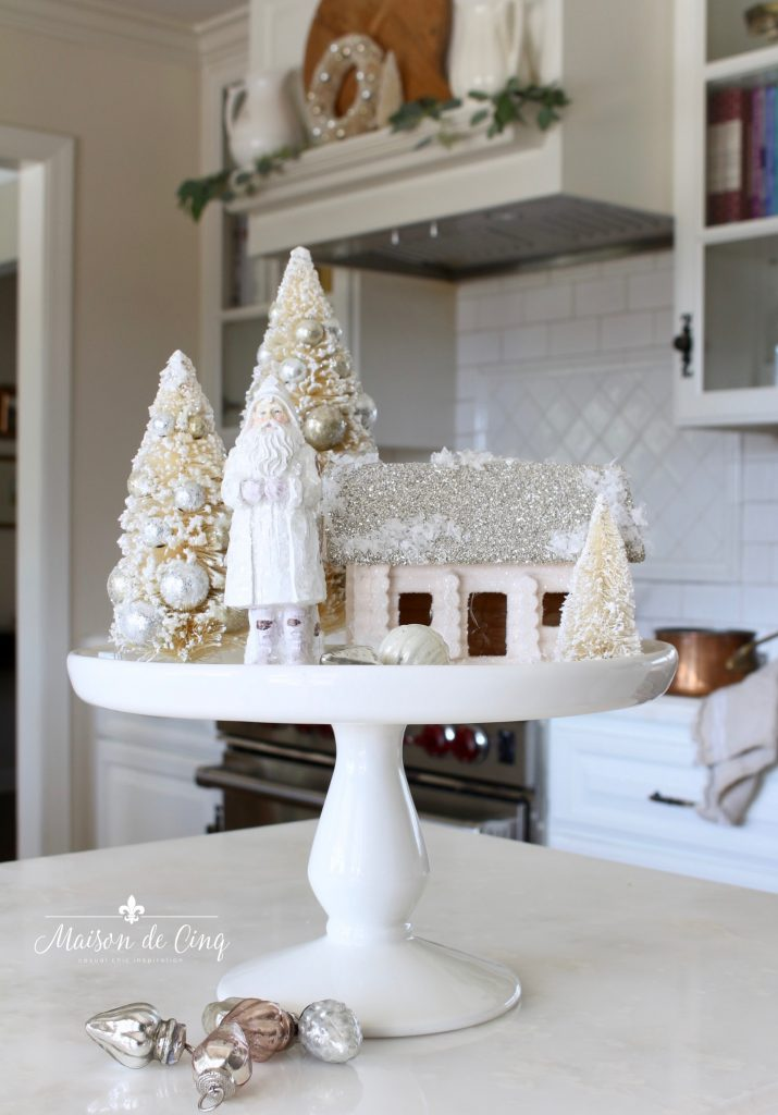 christmas kitchen tour white cake stand in white kitchen with bottle brush trees french country charm