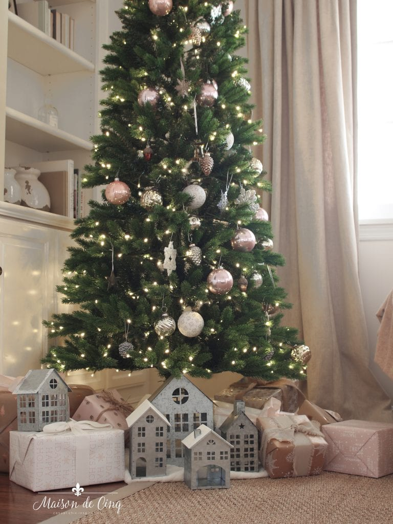 French farmhouse Christmas tree decorated in pink and white with galvanized houses and gifts holiday decor