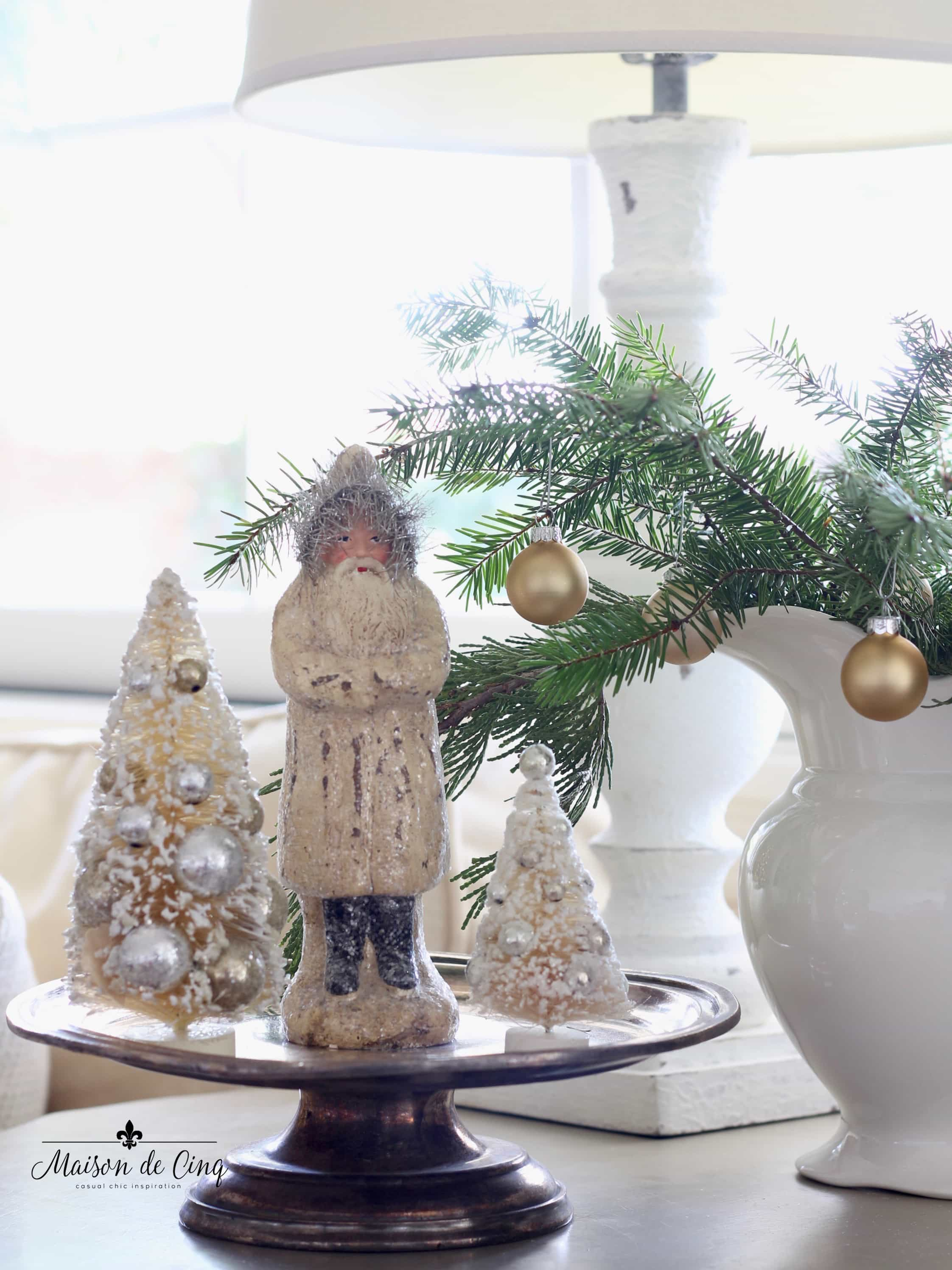 French farmhouse Christmas vignette on table vintage santa and bottle brush trees charming holiday decor