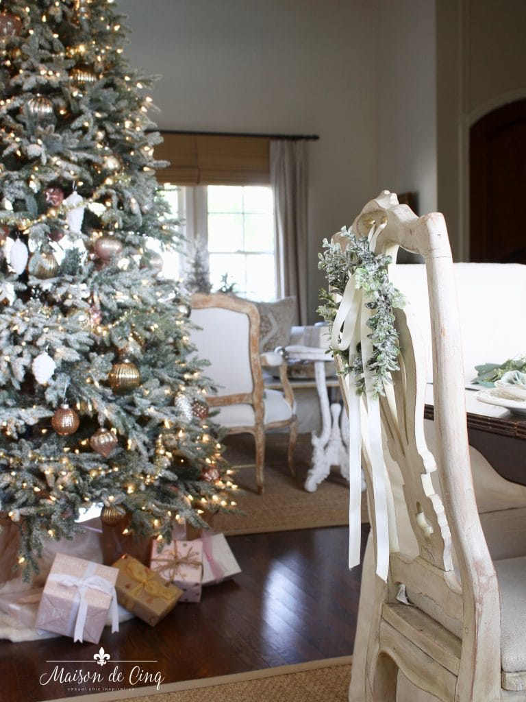 green and white christmas tablescape looking at christmas tree in dining room gorgeous french country style