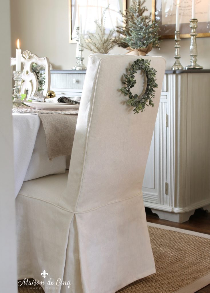 christmas table setting french country dining room white linen parsons chair wreath soft colors holiday decor