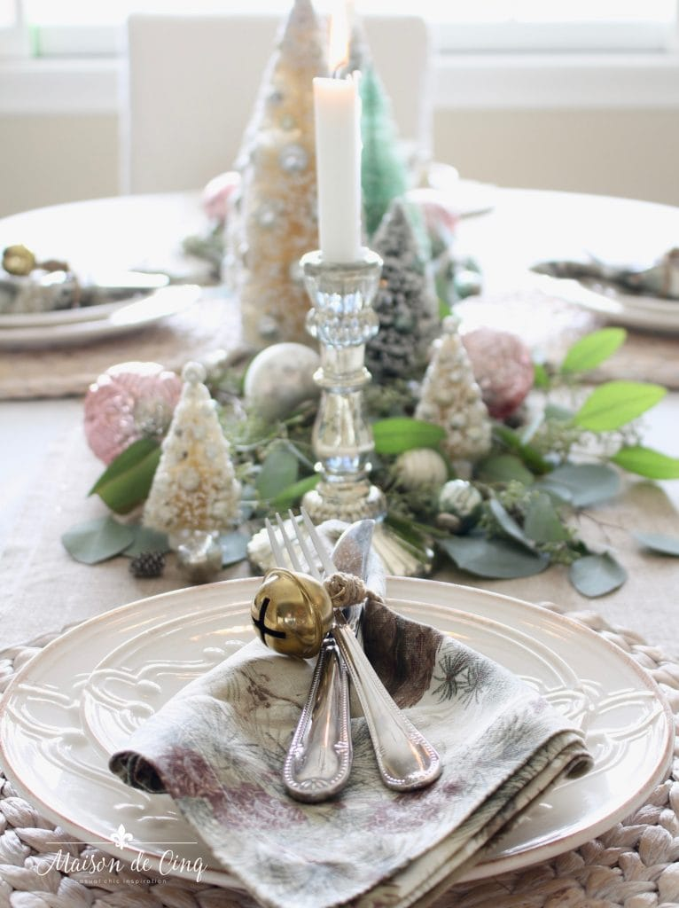christmas table setting soft romantic colors bottle brush trees silver mercury candleholders
