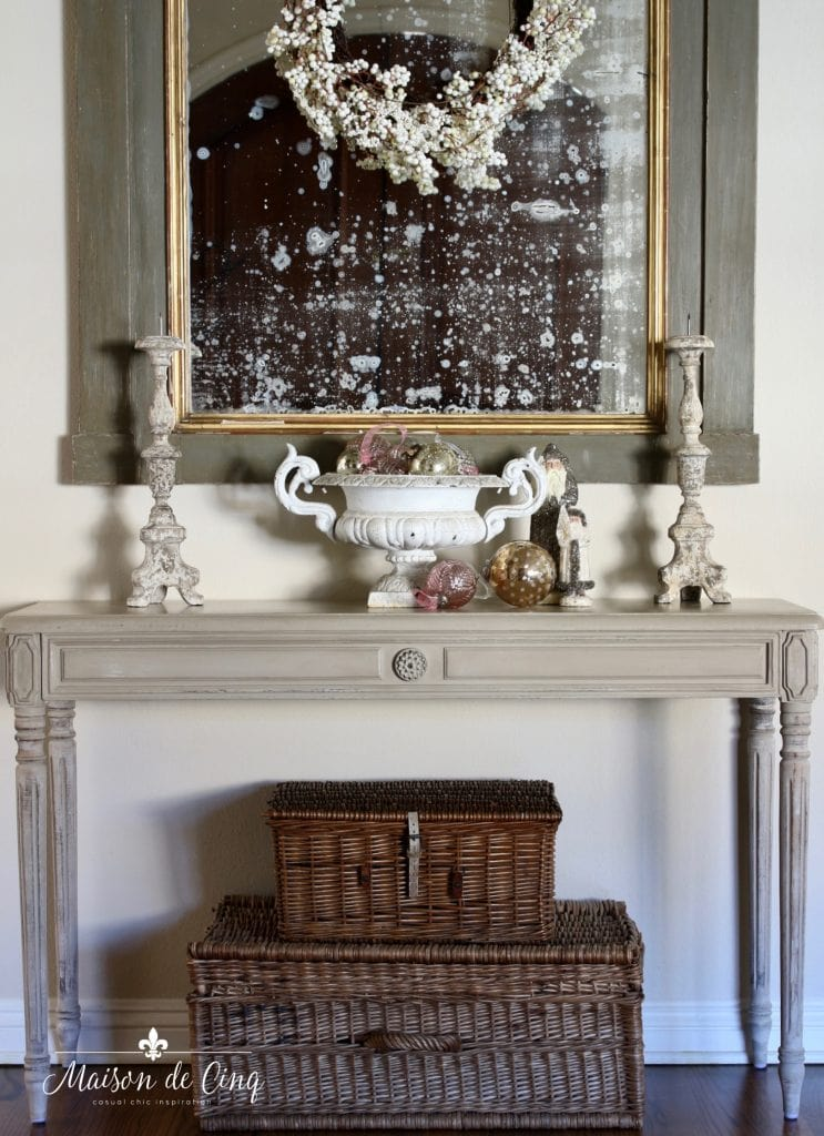 christmas entry way console table with french urn and ornaments