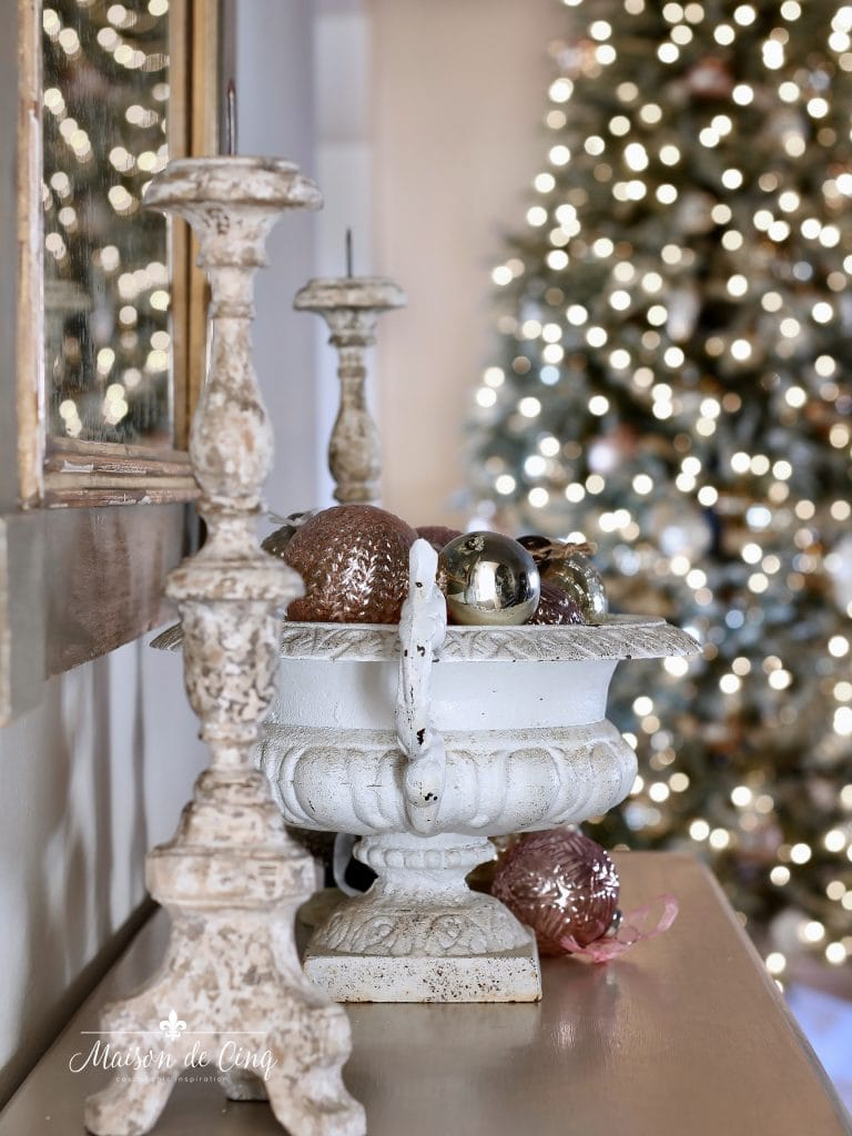 christmas entry way view of tree with french candle holders and urn with ornaments