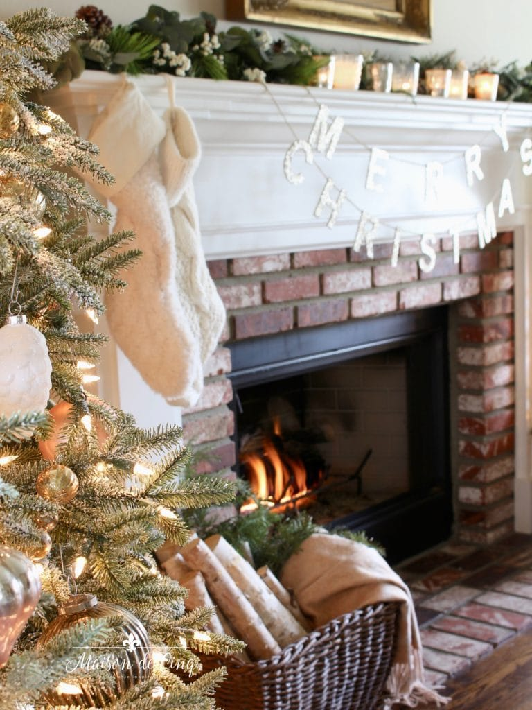 romantic christmas living room stockings mantel decorated with garland and candles