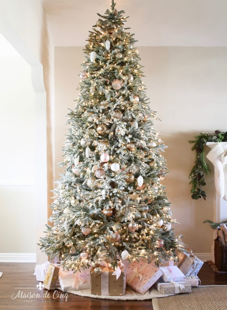 romantic christmas living room gorgeous flocked tree decorated with silver, white, and pink ornaments