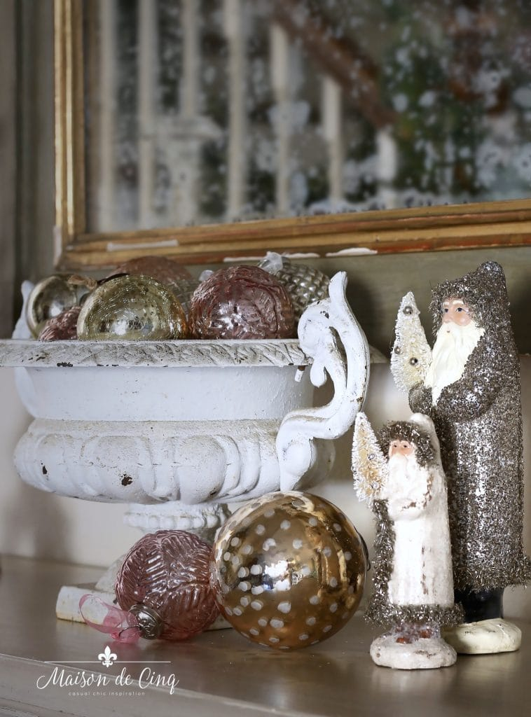 christmas entry way with ornaments and charming vintage santas