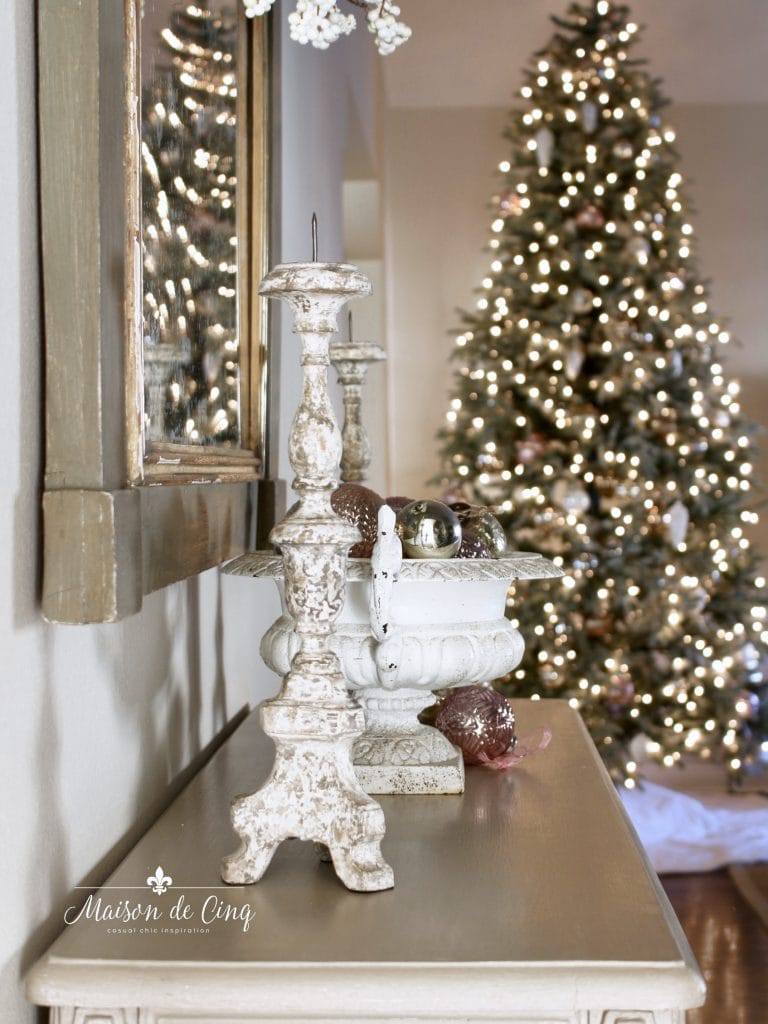 christmas entry way looking at christmas tree and candle and urn on table