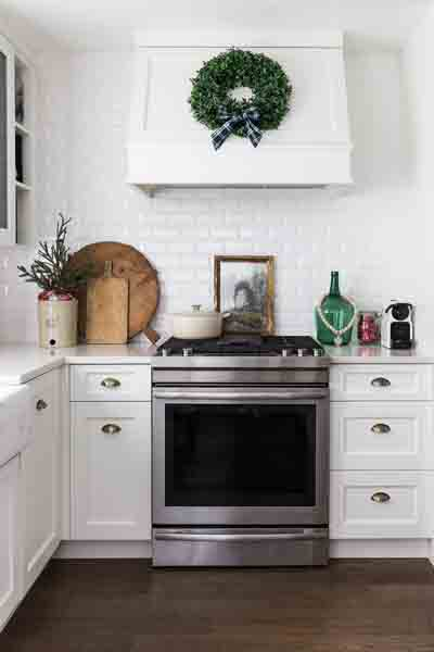 A white holiday kitchen decorated.