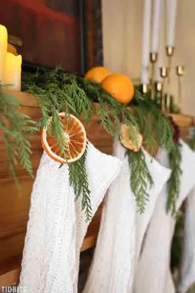Oranges used in a mantel display.