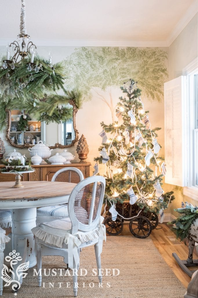 blue christmas decor ideas tree with vintage blue striped stocking ornaments in farmhouse dining room