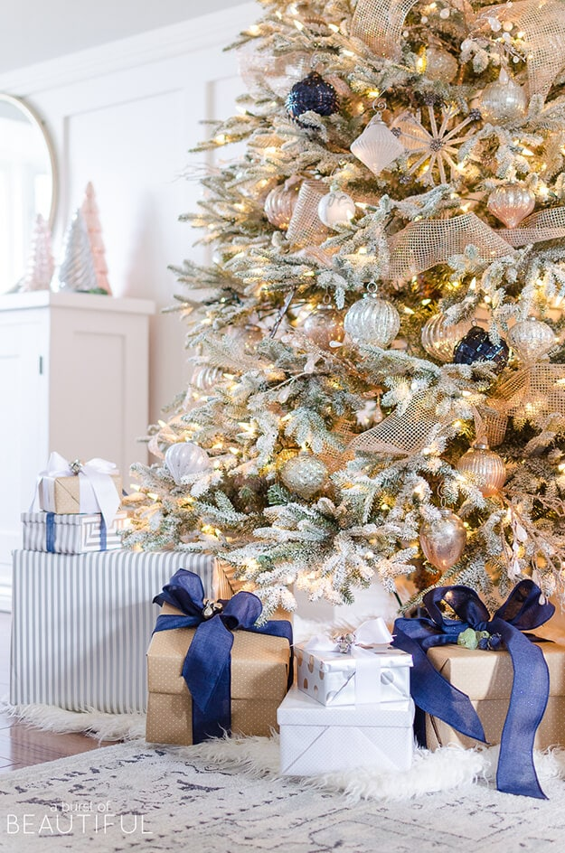 blue christmas decor ideas white and gold tree with blue ornaments and blue wrapped gifts