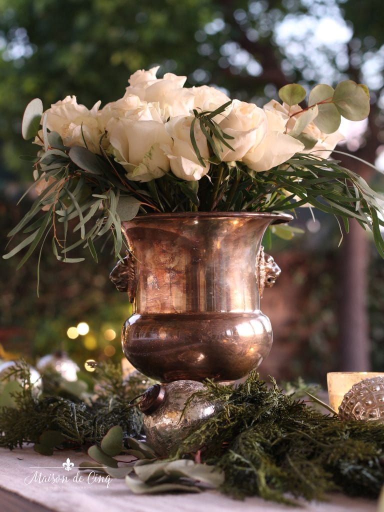 cozy Christmas patio white lights with roses and ornaments outside holiday table